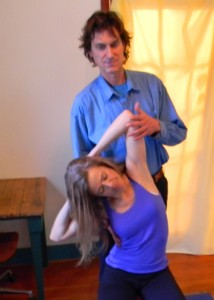 Roger Baril works with a client using somatic movement and massage therapy in his Paonia massage office.